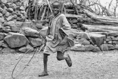 Konso Boy Play with a Natural Wheel Doketu Ethiopia