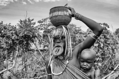 Mursi Mother and Son in a Village near Kuraz Omo Valley Ethiopia
