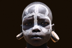 Mursi Boy with Face Paint Omo Valley Turmi Ethiopia