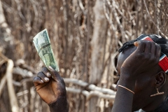 Hand and Money Omo Valley Ethiopia