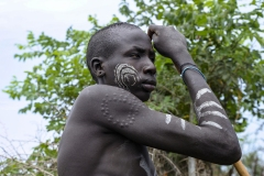 Young Mursi Warrior with Body Scarnification Omo Valley Turmi Ethiopia