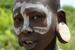 Mursi Boy with Face Paint Omo Valley Turmi Ethiopia
