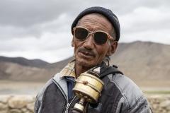 Nomad Changpa Man with Prayer Wheel Tsokara Area Ladakh India