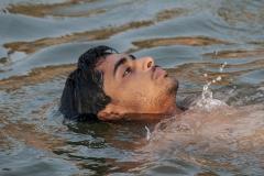 Man Swimming in Gange River Varanasi Uttar Pradesh India