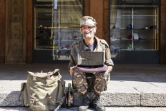 Homeless with Laptop Major Square Bologna Italy