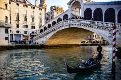 Gondola Transport on Channel with Rialto Bridge Venice Italy